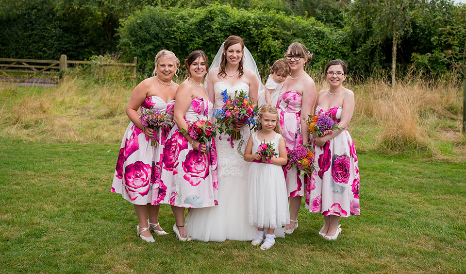 The bridesmaids wore white bridesmaid dresses with bright pink floral print – wedding ideas