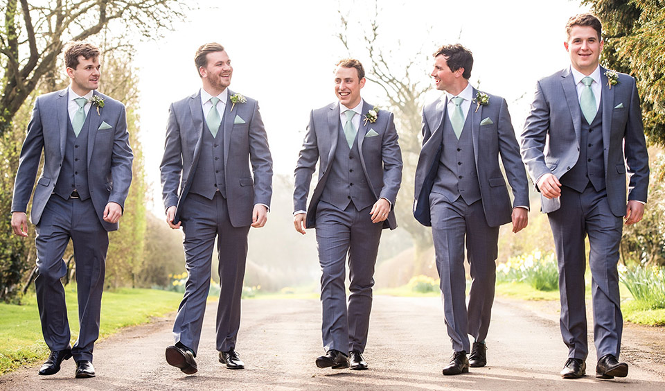 The groomsmen looked dapper in grey suits at this country barn wedding venue.