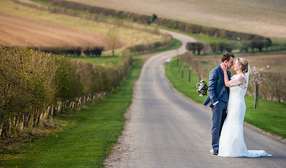 The happy couple shared a quiet moment at this idyllic country wedding venue in Hampshire