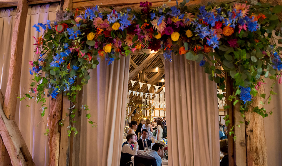 Guests dining in the wedding barn at this beautiful Hampshire wedding venue