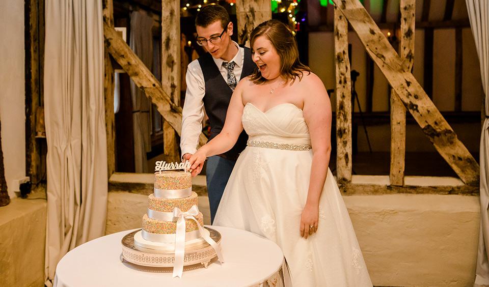 The happy newlyweds cut their wedding cake in the main barn – wedding cake ideas