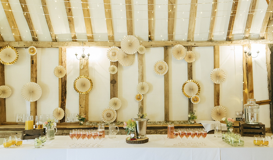 Pin wheels or paper cranes hung from the wall behind the top table create a fun and creative backdrop