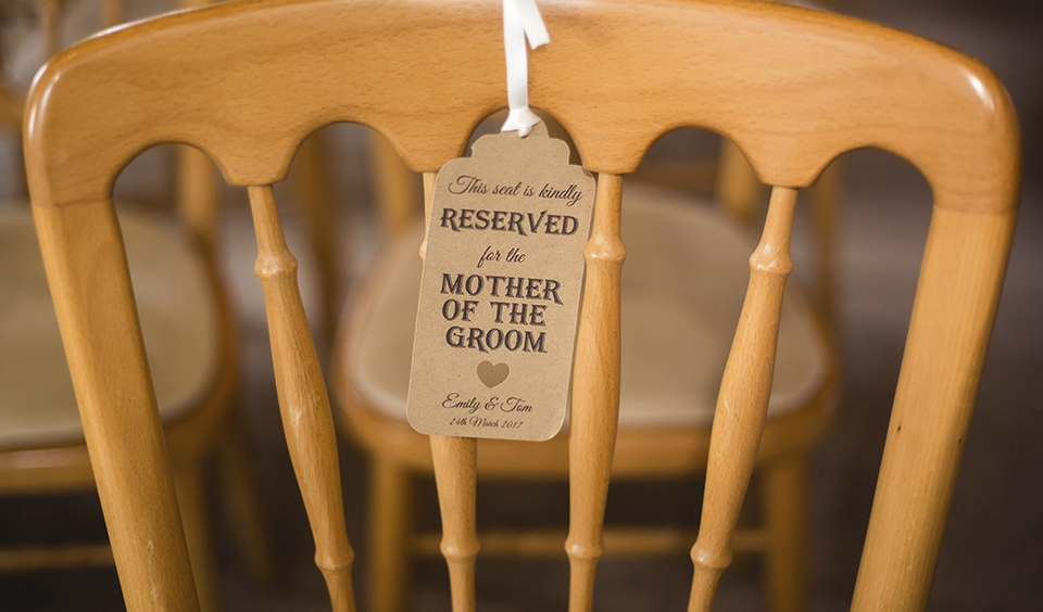Reserve seats during the wedding ceremony for your most important guests using luggage tags