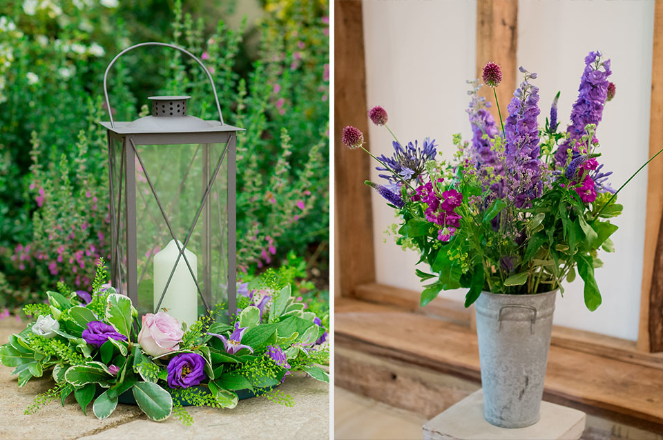 A lantern decorated with purple and pink flowers adds to the couple's stylish wedding decor