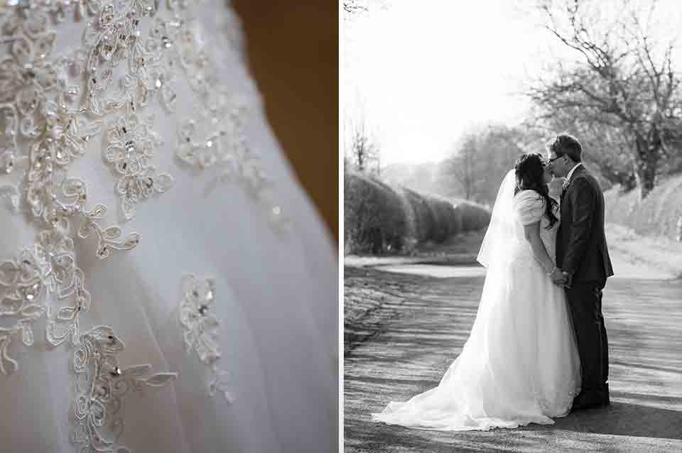 A close up of the bride's wedding dress with embroidered detail and the couple sharing a kiss