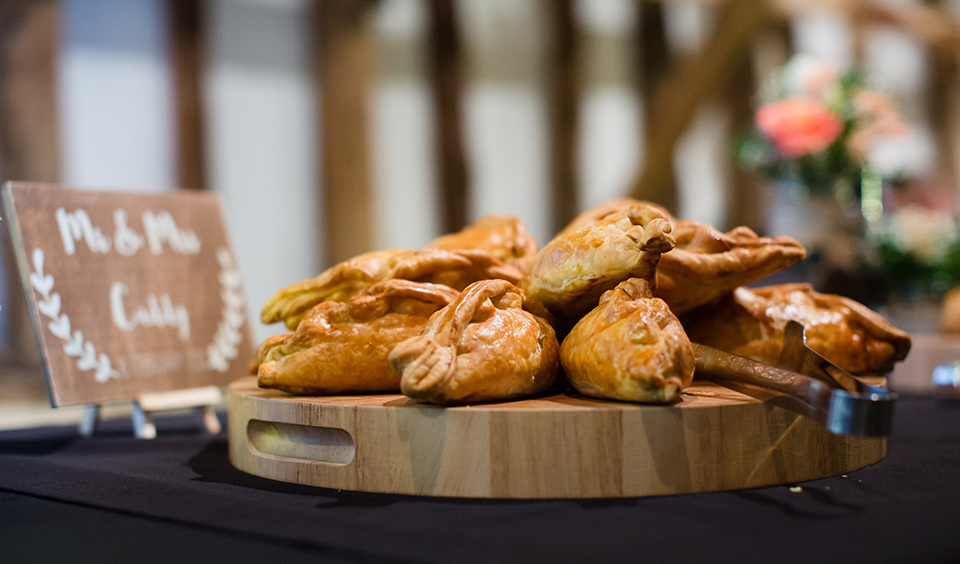 Delicious hot pasties are served at the evening wedding reception – wedding food ideas