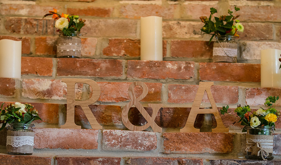 The couple decorated areas of the barn with rustic decorations like wooden letters and faux candles