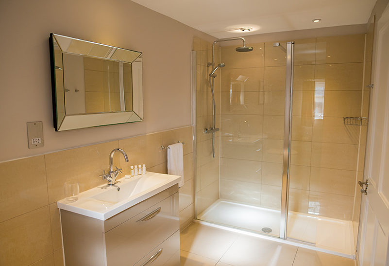 The bathroom in the Lavender Barn honeymoon suite at Clock Barn is modern and stylish