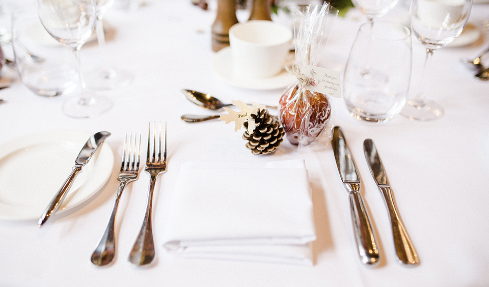 Delicious toffee apples are great as autumnal wedding favours with pine cones for place names
