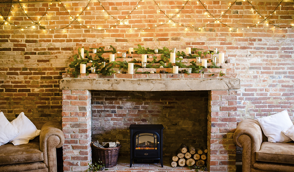 LED tea lights and candles are perfect for dressing fireplaces to create a warm cosy feeling at your winter barn wedding