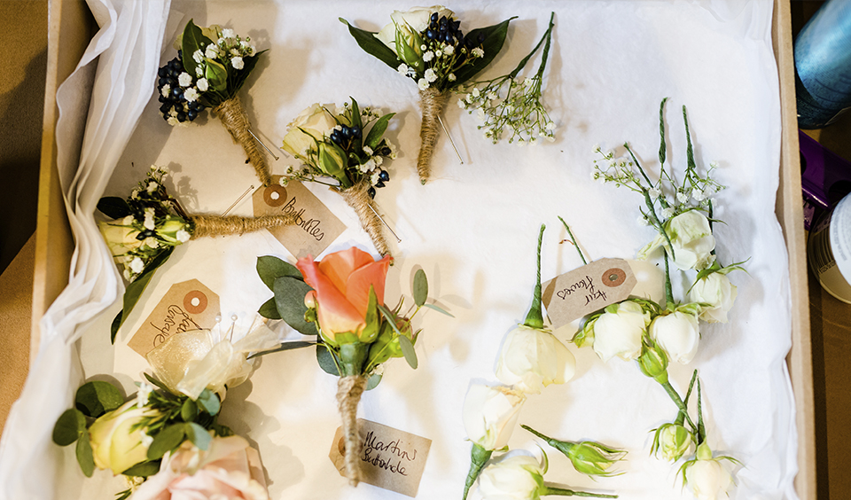 Eucalyptus, gypsophila and seasonal berries are perfect for creating pretty button holes for your rustic autumn wedding at Clock Barn in Hampshire