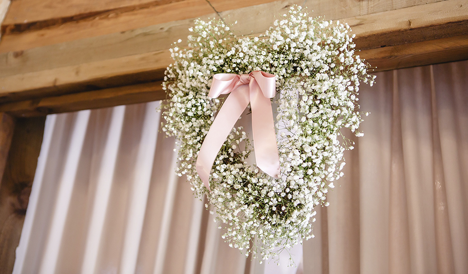 Heart shaped flower frames covered with lots of gypsophila look perfect at your romantic barn wedding at Clock Barn