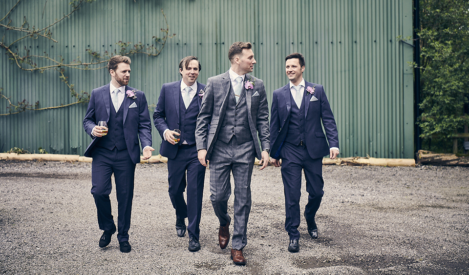 Incorporate different patterns and fabrics into three-piece suits for unique grooms wear at your barn wedding in Hampshire