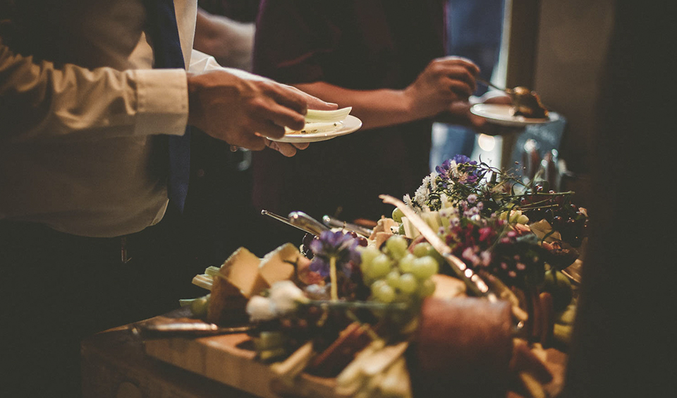 A delicious cheese board with breads and dipping oils is the perfect evening food choice for your barn wedding at Clock Barn in Hampshire