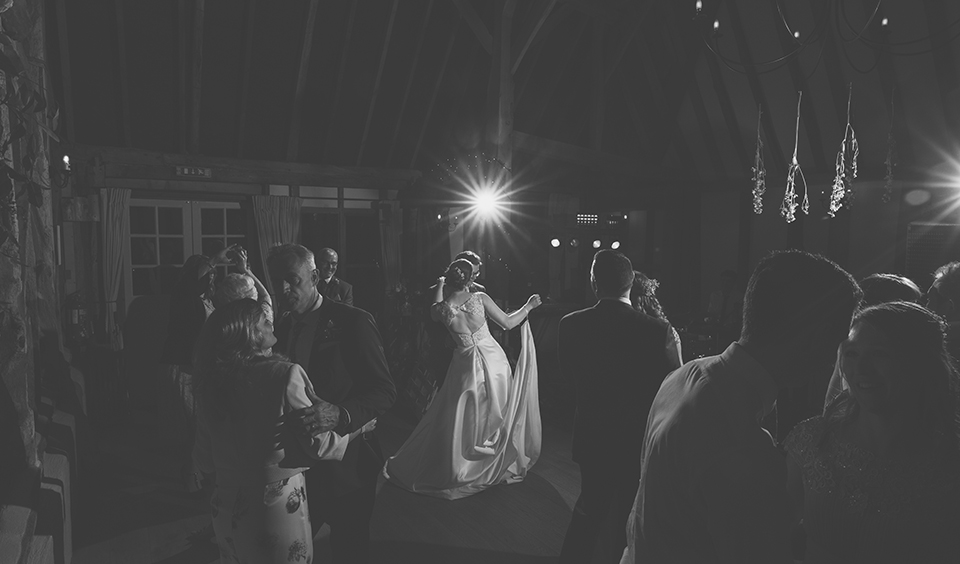 The bride and groom take to the floor for their first dance as a married couple at Clock Barn in Hampshire