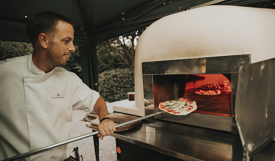 Woodfired pizza is the perfect evening food choice for your spring wedding at Clock Barn in Hampshire