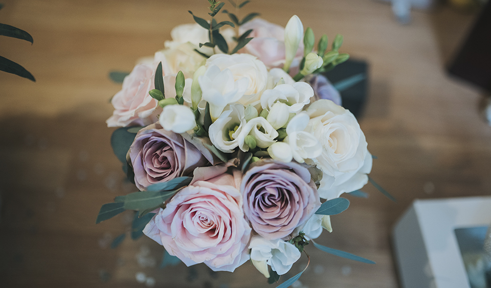 The bridal bouquet was a beautiful mix of white and pale pink roses at this barn wedding in Hampshire