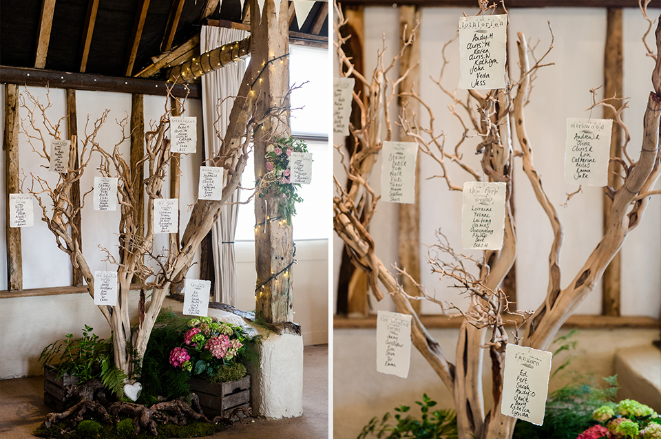Hang table seating detail onto branches to create a really rustic table plan for your barn wedding at Clock Barn