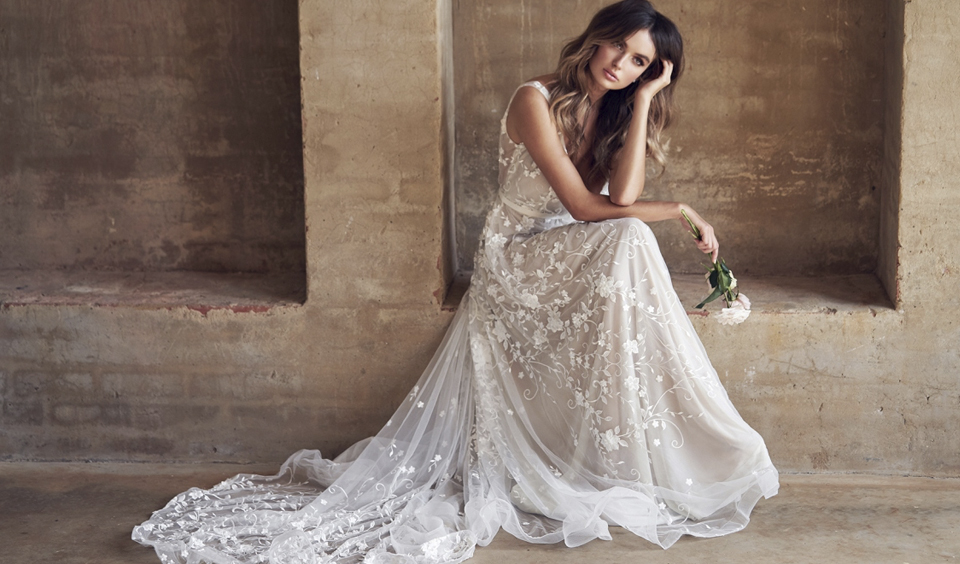 This wonderfully elegant embroidered wedding dress is perfect for a rustic barn wedding at Clock Barn in Hampshire