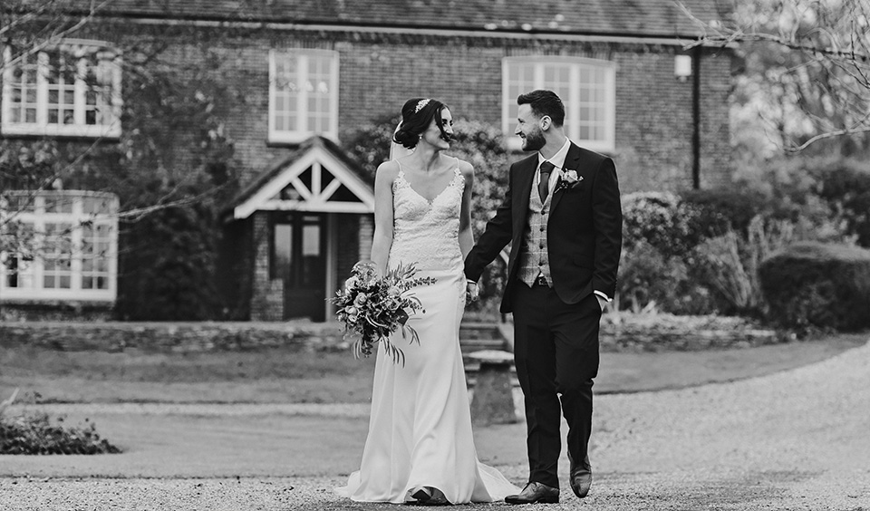 The happy newlyweds take some time out from the celebrations to have their wedding photos taken at Clock Barn in Hampshire