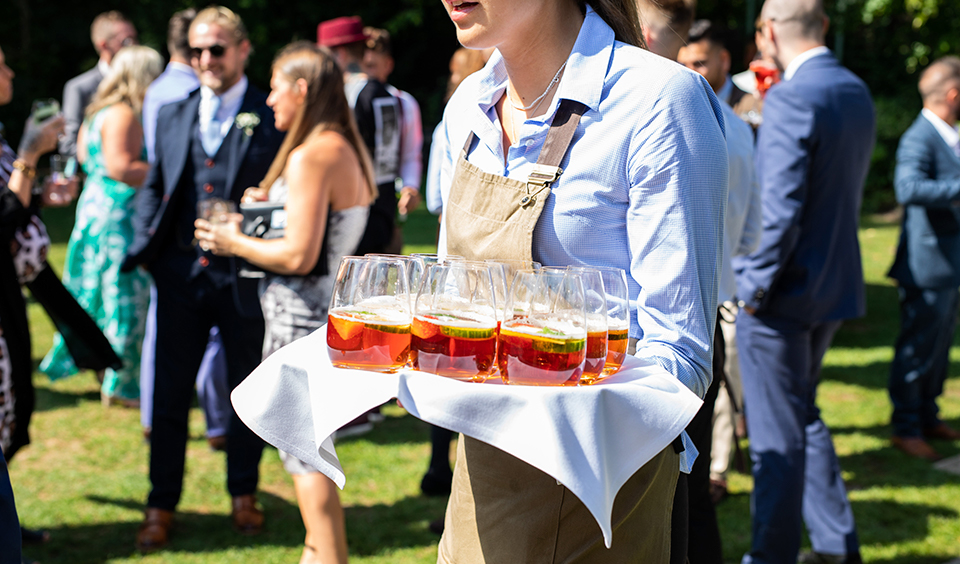 Refreshing glasses of Pimms were served at the drinks reception at this late summer wedding at Clock Barn