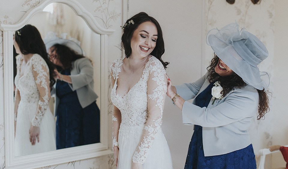 This beautiful lace long sleeved wedding dress is perfect for a rustic barn wedding in Hampshire