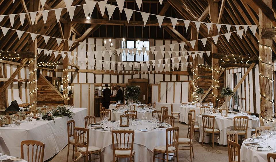 The barn was set up for the wedding breakfast at this winter wedding at Clock Barn in Hampshire