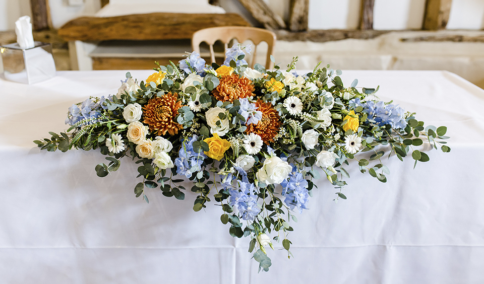The wedding table was decorated with a display of beautiful colourful wedding flowers